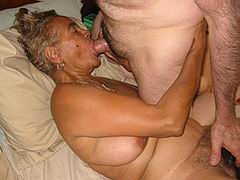 Horny granny does striptease in the kitchen